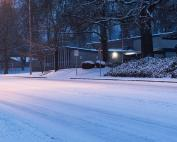 Photo of a snow-packed street in front of a school